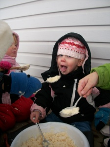 Teagan really Liked the Ice Cream, much better than the snow itself.