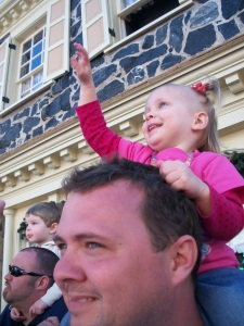 Sweet Girl waving to the princesses.