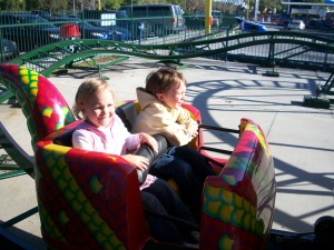 Jess and Tim on the kids roller coaster, he is a daredevil, and she was willing to try anything that day.
