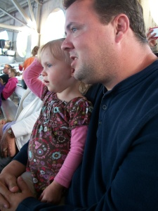 Teagan watching the show with Daddy